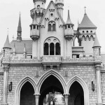Walt Disney walking through Sleep Beauty Castle